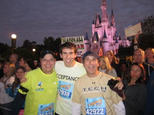 Mark, son, and brother running at Disney World